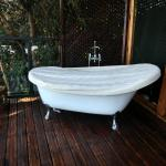 A bathtub in the open with the valley view. Nothing can beat that!