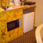 Kitchenette with sink, microwave, and fridge