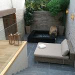 The Onsen bath with a daybed and outdoor dining table for 2.