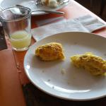 Omelette was not tasty. Too dry. Probably did not add enough oil and water. Fruit drink too swee