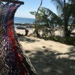 Hammock located in shade near the beach downhill from Family Suite
