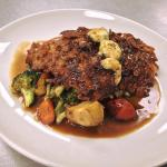 Potato Encrusted Local Chicken Breast over Vegetable Medley finished with Bleu Cheese Demi