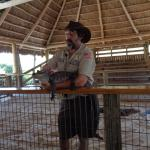 He was asking the visitors to come forward and hold this baby crocodile.
