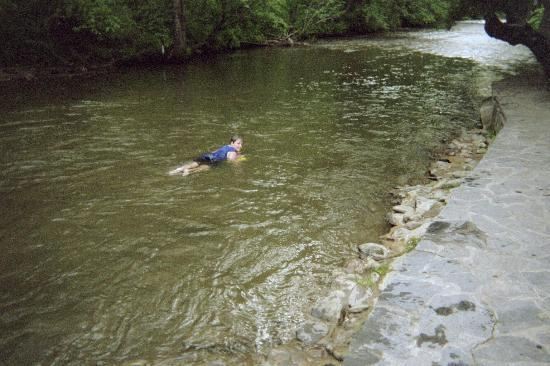 Riverside Motel: My son floating in the river outside our room.