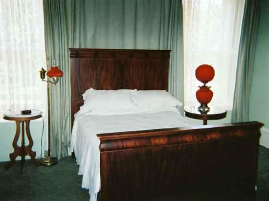 Cimarron, NM: Color photo of the bed in the Governor's Room.