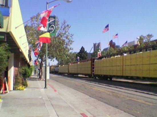 Oakland, CA: Freight train passing the front entrance