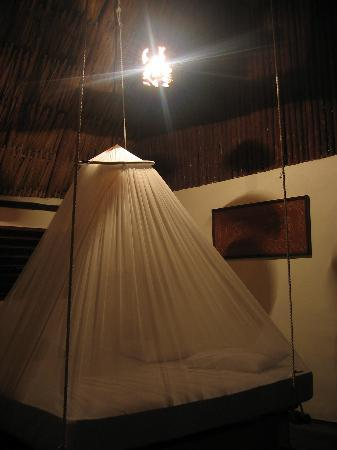 Siki's Room Bed-hanging-from-ceiling