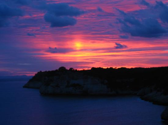 Cala Galdana, Espagne : A sunset view from a Sol Gavilanes Bedroom Balcony - Wow! 