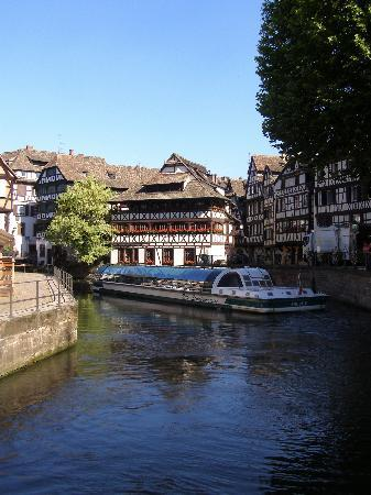 , : An early morning boat trip through the Petite France area of Strasbourg.