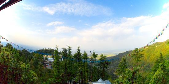 Dharamsala, India: View from the Pema Thang rooms is stunning. Kangra Valley in distance. Temple on left.