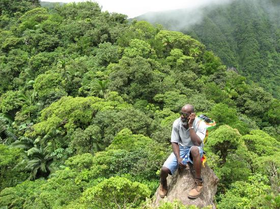 St. Kitts and Nevis: Volcano Hike guide takin' a call at the crator
