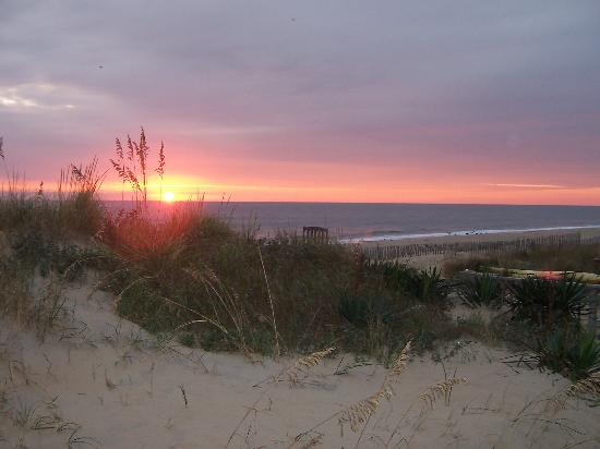 -, : Sunrise from the deck of the beach house