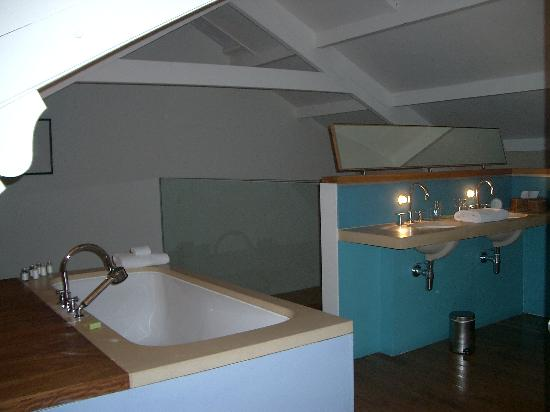 Mezzanine bathroom - wash basins (note light shines from beneath ...