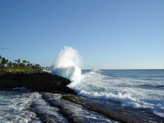 Kapolei, HI: Surf hitting the rock wall
