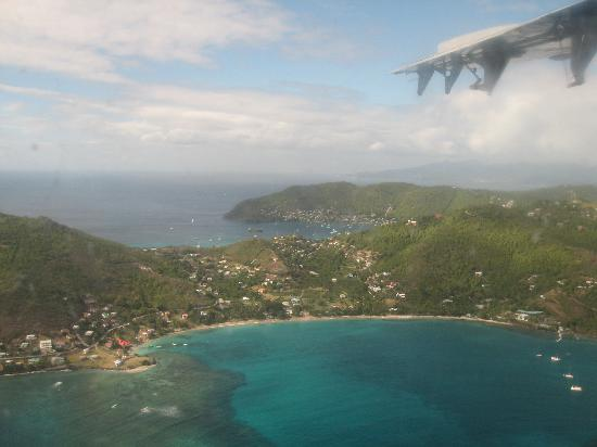 Bequia Beachfront Villas: Friendship Bay from the air (Villa with red roof on left)