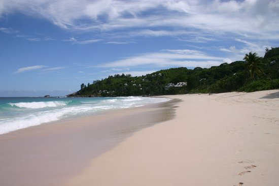 Mahe Island, Seychelles: Beach with Hillside Villas behind