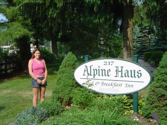 Alpine Haus Bed and Breakfast Inn: Brooke in front of the sign
