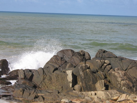 Galle, Sri Lanka: Waves crashing onto the rocks as seen from the open air dining area