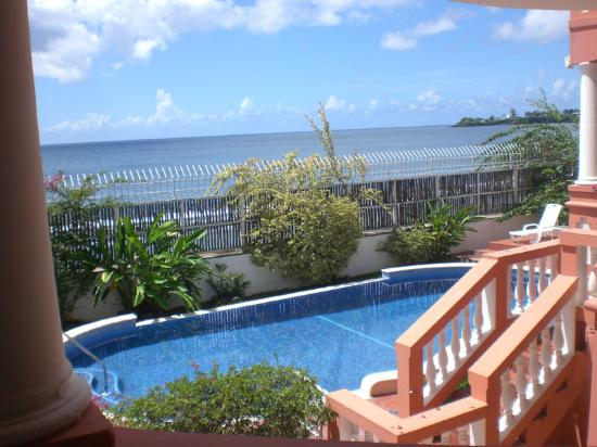 Front view of villa picture of mirage tobago Hotels in scarborough with swimming pool