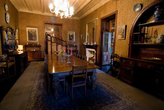 A cute haunted mansion on a hill chapslee pictures for Haunted dining room ideas