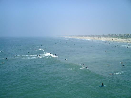 view from the pier of Huntington Beach surfers