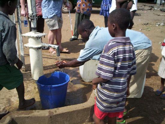 Liberia : checkin old wells to make sure they are in working order 