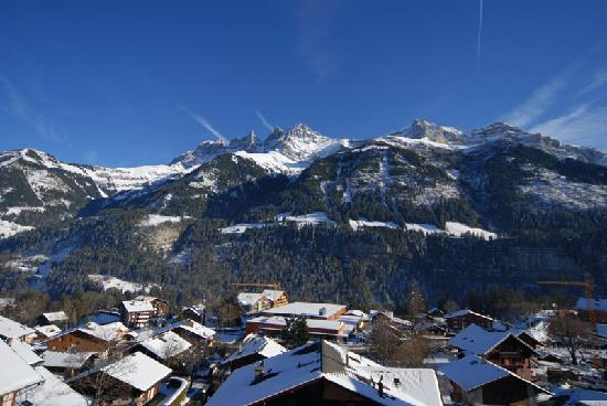 Hotel Suisse: View across village and Dent du Midi from room balcony