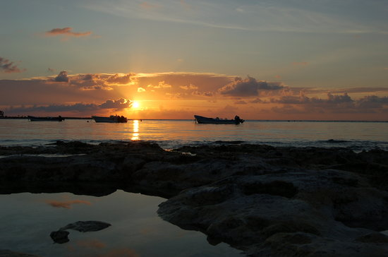 , : A walk on the beach at Akumal Bay lead to some beautiful sunrise photos