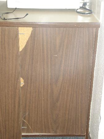 San Juan Motel: Scarred, torn and dilapidated cabinet.