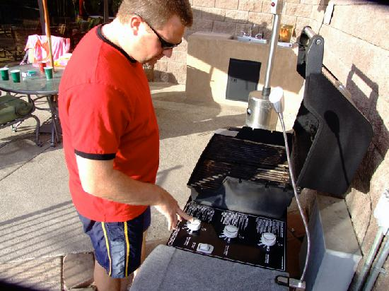 Queens Bay Resort Condos: Trying to fire up the broken grill!