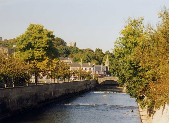 Bridgend, UK: River with Newcastle Hill and Castle in background