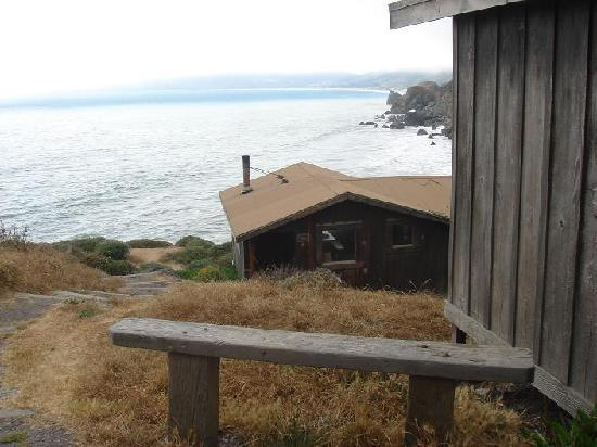 Mill Valley, : The bench outside our cabin, with Stinson Beach in the background