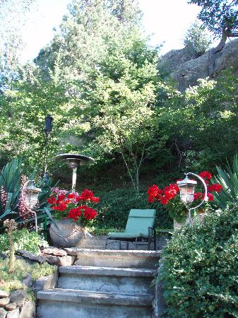 Montcalm Garden Bed & Breakfast: a view up the stairs to the terrace lounge area