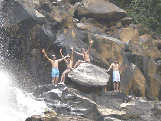 Karnataka, India: Trekkers enjoying at the falls
