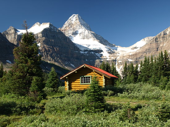 Mount Assiniboine Lodge: Mt. Assiniboine Lodge.  Mt. Assiniboine cabin w/ Mt. Assiniboine in background.