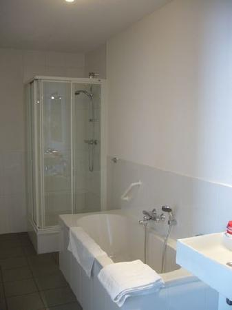 Quartier Du Port: Bathroom, 2 sinks, separate tub & walk-in shower