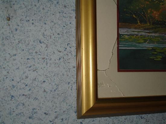 Laurel, MD: broken glass above the bed