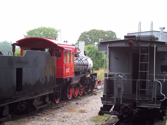 Engines and Cars In The Outside Yard