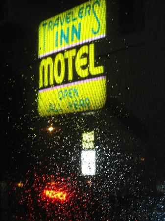 Traveler's Inn: The sign from our room window overlooking the street