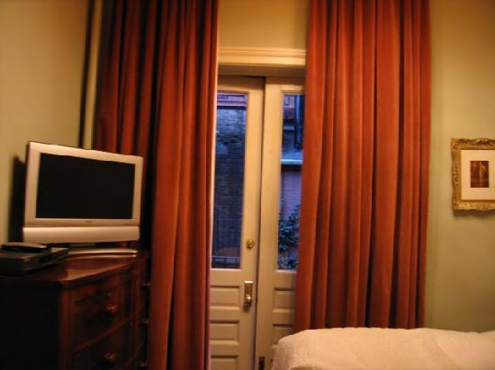 Lafayette House: Dusty Rose velour curtains leads out to...