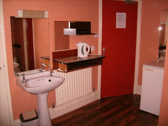 outdated decoration random sink in bedroom area and no cups or tea or