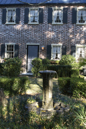 Charlotte Street Cottage: Fountain In front of the Cottage