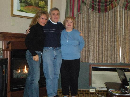 Comfort Inn &amp; Suites: our pic by the fireplace