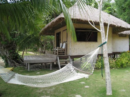 ‪‪Sangat Island Dive Resort‬: Sangat Island Beachfront room with hammock‬