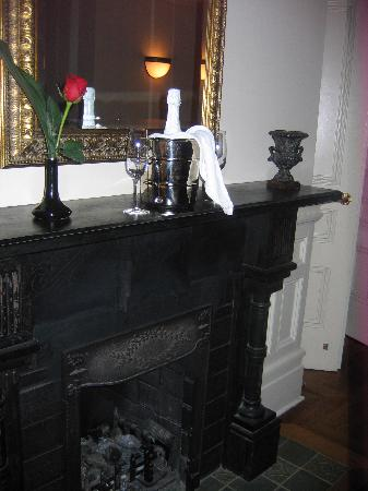 Wentworth Mansion: fireplace + champagne + rose