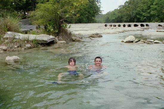 7A Ranch Resort: The boys wading in a deeper area of the river infront of 7a