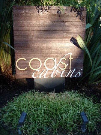 Coast Cabins sign & wonderful plants