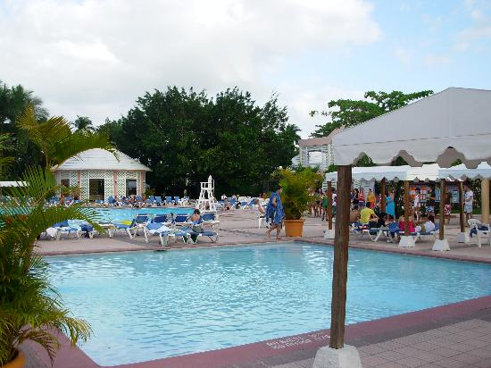 Puerto Plata Village Resort: The Kids & Adults Pools, Activity Crew to the Right teaching people to dance.