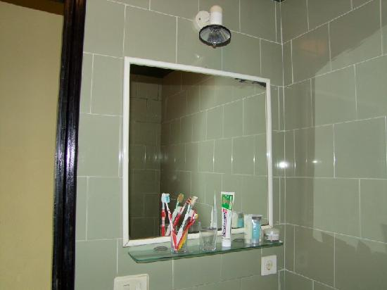 Tilted Mirror In Bathroom Equipment On Shelf Is Ours
