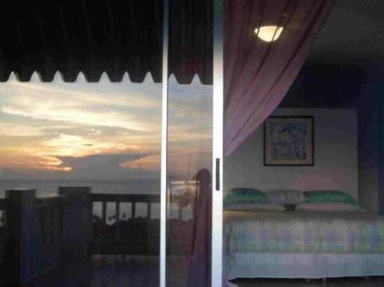 Desecheo Inn: Sunset reflected off slideing Door Bedroom